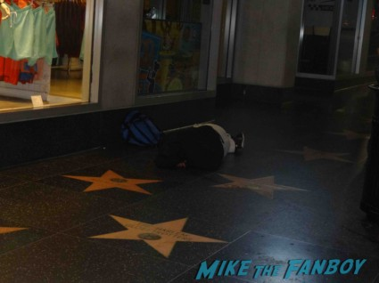 a man passed out on hollywood blvd I get to the premiere a little early. I'm the 3rd person there.  Actually I'm the 4th person there if you count the guy passed out on  Hollywood Blvd.