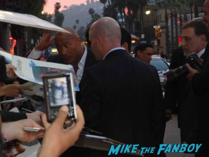 dwayne johnson the rock arriving to the  g.i. joe retaliation movie premiere report red carpet rare promo bruce willis red carpet the rock