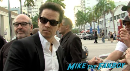 sexy mark wahlberg signing autographs on the red carpet at the pain and gain movie premiere miami mark wahlberg hot sexy signing autographs (5)