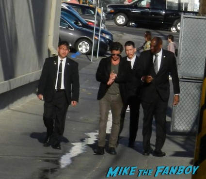patrick dempsey arriving to tape jimmy kimmel live  elisabeth moss signing autographs for fans 001