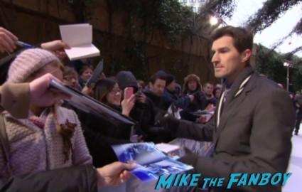 director Joseph Kosinski  signing autographs at  the oblivion uk movie premiere red carpet tom cruise signing autographs oblivion uk movie premiere (1)