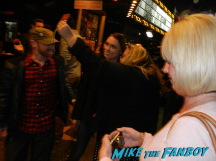 pinky getting a photo with a random girl as ugly naked shirtless man walking around hollywood blvd zachary levi from chuck signing autographs for fans at pieces of ass 10th anniversary at the ford theater