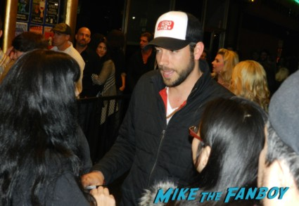 zachary levi from chuck signing autographs for fans at pieces of ass 10th anniversary at the ford theater