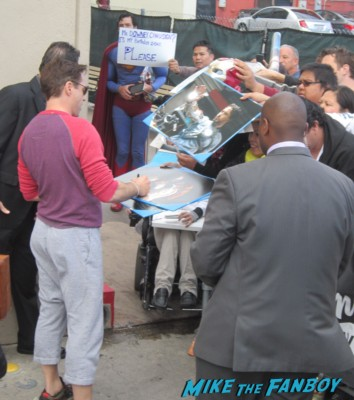 robert downey jr. signing autographs for fans before a talk show taping
