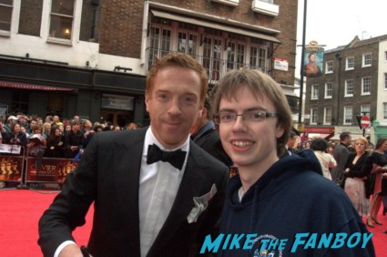 Damian Lewis signing autographs at the The olivier awards red carpet 2013 with daniel radcliffe kim cattrall rre signing autographs