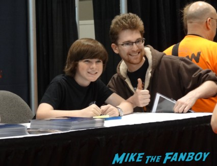 chandler riggs from the walking dead signing autographs at the Chicago Comic and entertainment expo c2e2 banner logo rare