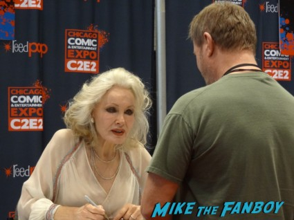 Julie Newmar signing autographs at the Chicago Comic and entertainment expo c2e2 banner logo rare