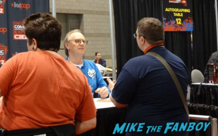 Burt Ward signing autographs at the Chicago Comic and entertainment expo c2e2 banner logo rare