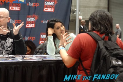 Janina Gravatar signing autographs at the Chicago Comic and entertainment expo c2e2 banner logo rare