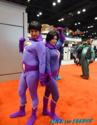 wonder twins cosplayers at the Chicago Comic and entertainment expo c2e2 banner logo rare