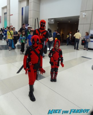iron man cosplayers at the Chicago Comic and entertainment expo c2e2 banner logo rare
