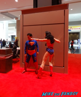 wonder woman spider man cosplayers at the Chicago Comic and entertainment expo c2e2 banner logo rare