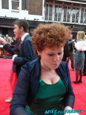 imelda Staunton  signing autographs at the The olivier awards red carpet 2013 with daniel radcliffe kim cattrall rre signing autographs
