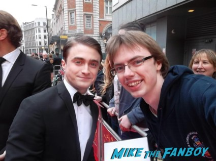Daniel Radcliffe signing autographs at the The olivier awards red carpet 2013 with daniel radcliffe kim cattrall rre signing autographs