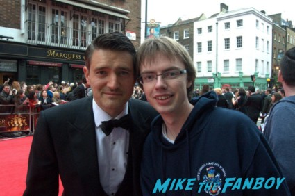 Tom Chambers signing autographs at the The olivier awards red carpet 2013 with daniel radcliffe kim cattrall rre signing autographs