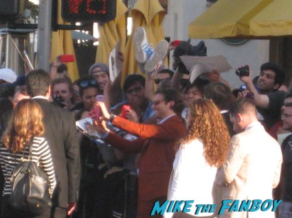 Bradley cooper signing autographs at The Hangover Part III red carpet Movie Premiere Photos! Bradley Cooper! Ed Helms! Zach Galifianakis! Justin Bartha! Heather Graham! Jamie Chung! And More!