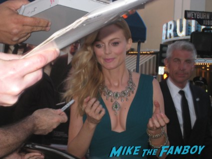Heather Graham signing autographs at The Hangover Part III red carpet Movie Premiere Photos! Bradley Cooper! Ed Helms! Zach Galifianakis! Justin Bartha! Heather Graham! Jamie Chung! And More!
