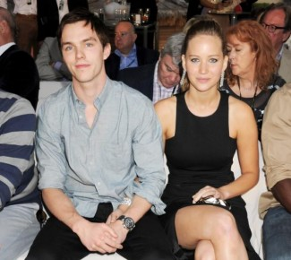 nicholas Hoult and Jennifer lawrence holding hands at an event.  hot sexy about a boy star