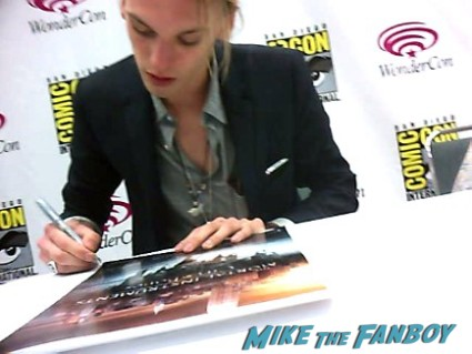 Jamie Campbell-Bower signing autographs at the Mortal Instruments autograph signing Cassandra Clare! Lily Collins! Jamie Campbell-Bower! Kevin Zegers! Autographs! Photos! More!