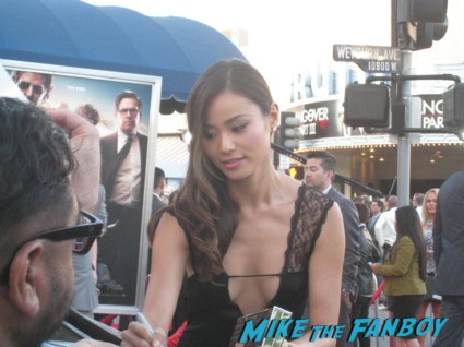 Jamie Chung signing autographs at The Hangover Part III red carpet Movie Premiere Photos! Bradley Cooper! Ed Helms! Zach Galifianakis! Justin Bartha! Heather Graham! Jamie Chung! And More!