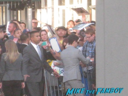Justin Bartha signing autographs at The Hangover Part III red carpet Movie Premiere Photos! Bradley Cooper! Ed Helms! Zach Galifianakis! Justin Bartha! Heather Graham! Jamie Chung! And More!