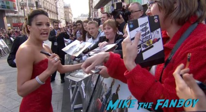 Michelle Rodriguez signing autographs Fast And Furious 6 London UK Premiere Report & Photo Gallery! Paul Walker! Luke Evans! Vin Diesel! Michelle Rodriguez! Jordana Brewster! Ludacris! Tyrese! Autographs! Photos! And More!