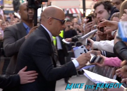 Vin Diesel signing autographs Fast And Furious 6 London UK Premiere Report & Photo Gallery! Paul Walker! Luke Evans! Vin Diesel! Michelle Rodriguez! Jordana Brewster! Ludacris! Tyrese! Autographs! Photos! And More!