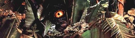 Jurassic park logo title dinosaur peeking through the jungle
