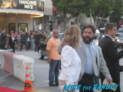 Zach Galifianakis  signing autographs at The Hangover Part III red carpet Movie Premiere Photos! Bradley Cooper! Ed Helms! Zach Galifianakis! Justin Bartha! Heather Graham! Jamie Chung! And More!