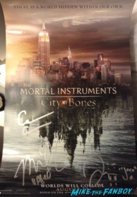 Mortal instruments signed autograph mini poster wondercon lily collins signing autographs at the Mortal Instruments autograph signing Cassandra Clare! Lily Collins! Jamie Campbell-Bower! Kevin Zegers! Autographs! Photos! More!