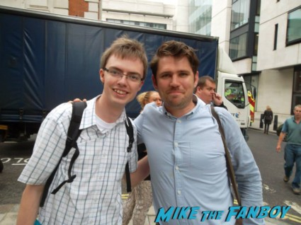 Roy Stride from Scouting for Girls signing autographs for fans