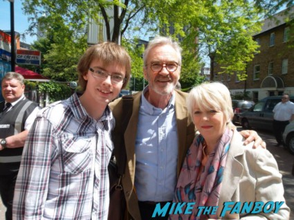 Larry Lamb and Alison Steadman signing autographs for fans in london
