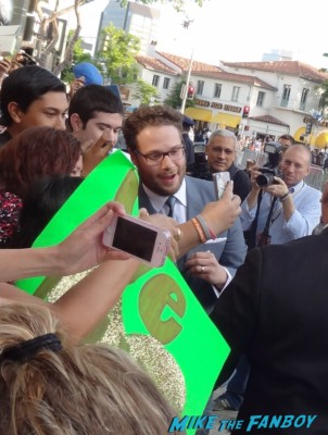 seth rogen signing autographs  at the this is the end movie premiere in westwood