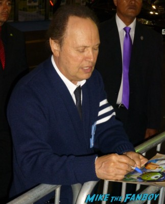 Billy Crystal signing autographs for fans Monsters university premiere marquee sign rare billy crystal