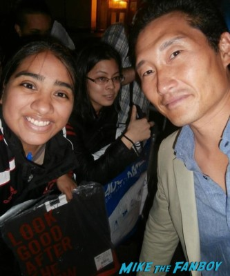 Daniel Dae kim signing autographs for fans Man Of Steel Movie Premiere