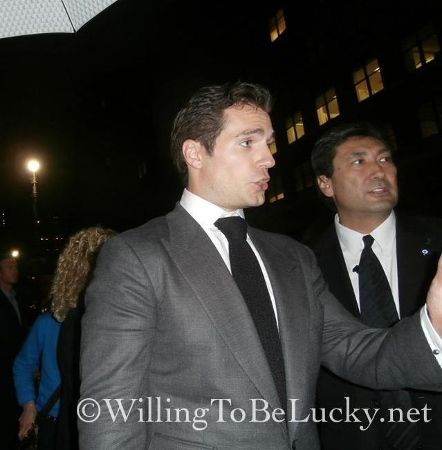 Henry Cavill signing autographs for fans Man Of Steel Movie Premiere