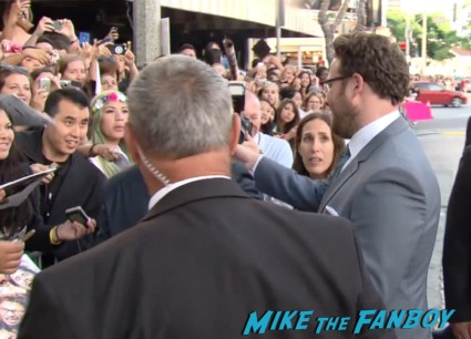 seth rogan signing autographs for fans This Is The End Movie Premiere red carpet