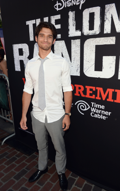 tyler posey on the red carpet at the Lone Ranger Movie Premiere signing autographs