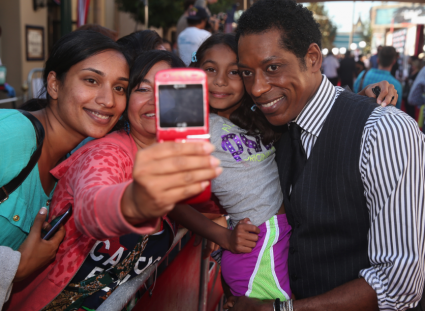 orlando jones on the red carpet at the Lone Ranger Movie Premiere signing autographs