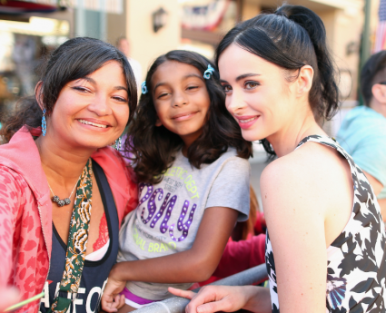 krysten ritter on the red carpet at the Lone Ranger Movie Premiere signing autographs