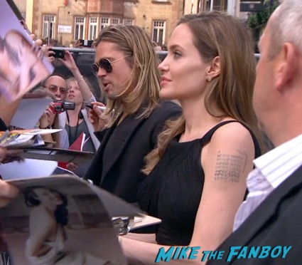 Angelina Jolie and Brad pitt signing autographs for fans World War z movie premiere london brad pitt angelina jolie signing autographs red carpet (11)