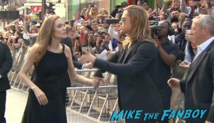 Angelina Jolie and Brad pitt red carpet World War z movie premiere london brad pitt angelina jolie signing autographs red carpet (11)