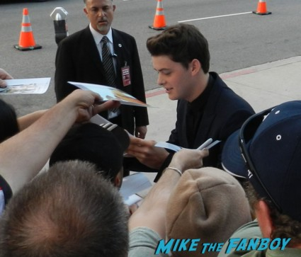 Israel Broussard signing autographs at the bling ring movie premiere emma watson signing autographs 038
