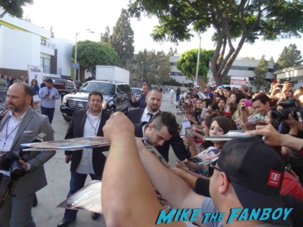 Jay Baruchel signing autographs for fans at the this is the end movie premiere