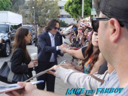 paul rudd signing autographs for fans at the this is the end movie premiere