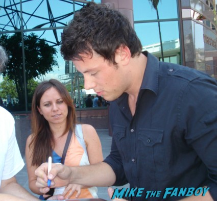 Corey Monteith signing autographs for fans at a glee screening at outfest