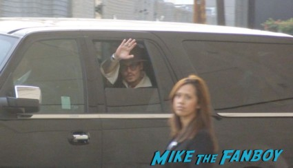 Johnny depp leaving a taping of jimmy kimmel live rare waving from inside his van