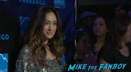 maggie q arriving at the  hot at the Summit Entertainment Party Comic Con asa butterfield signing autographs rare vv