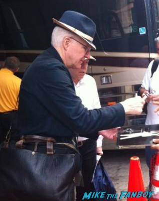 Steve Martin signing autographs for fans before his folk show rare
