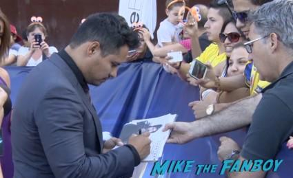 Michael Pena signing autographs for fans Turbo Barcelona Premiere red carpet snoop dog signing autographs